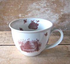Bees and Hives Mug, Teacup style Tea Cup with Skeps, 14 oz Porcelain Coffee Mug, Ready to Ship. $20.00, via Etsy.