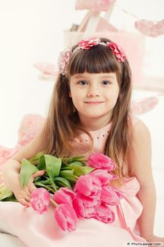 Beautiful little girl with flowers