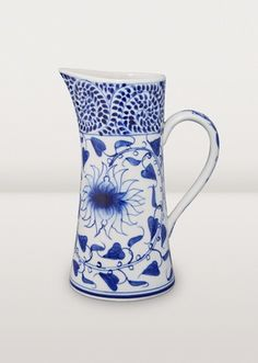 This graceful pitcher lets you share the bounty of summer beverages. A beautiful addition to your luncheon table or breakfast on the deck. In traditional Vietnamese blue and white ceramic.