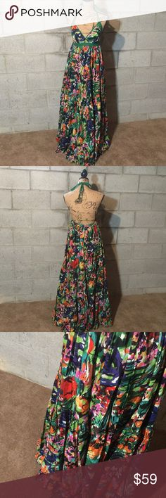 Moda International watercolored Tiered Maxi Dress Beautiful multicolor tiered halter dress! Has an elastic band on the back so no zipper or buttons. Moda International Dresses Maxi