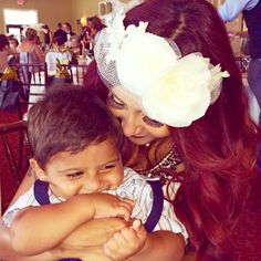 """Pregnant Nicole """"Snooki"""" Polizzi was the guest of honor at a bridal shower in her hometown of Poughkeepsie, NY. The bride-to-be got dolled up for her Great Gatsby-themed party in a white dress and accessorized with a chic flower headband! She shared this adorable pic of herself and son Lorenzo!"""