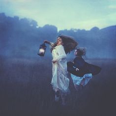 Running from wind; Love this picture, the lighting, the mist, the lantern, and fog. There expression is amazing!!