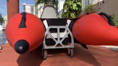 Using folding hand cart to move inflatable boat Inflatable Boats, Hand Cart, Folded Hands