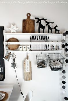 i am totaly in love with this decorated shelf, lovely nordic christmas style in white, black and wood