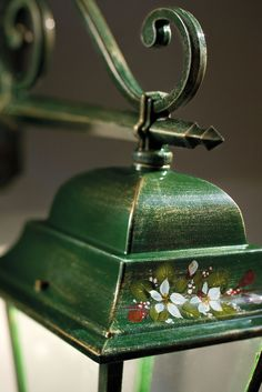 Flowers finely hand decorated on alluminium outdoor lamp.