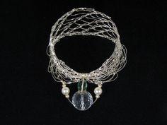 Woven silver wire, crystal, pearl bracelet
