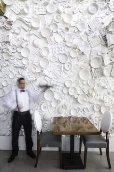 high impact wall with plates and cooking implements - wall decor inspiration  Dyanon Bistro | Jannina Cabal | Archinect