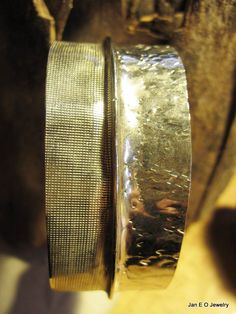 German silver sheet metal has been heated and hammered to make this primitive tribal fold form cuff. The cuff has two different textures with a hammered texture on one side and a cloth like pattern on the other. Fold forming is a very organic process where the natural tendencies of the metal and the transforming nature of fire are used to form the jewelry.