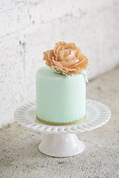 This glamorous mint-green one with a fabulous sugar flower. | 24 One-Tier Wedding Cakes That Prove That Less Is More