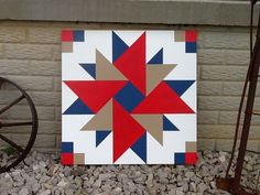 Double Aster Barn Quilt. Love the colors and design, but I don't like my corners. The blue should be across from blue and the tan should have been across from tan. Oh well... I still like the country feel to this one. I may put a monogram in the middle.