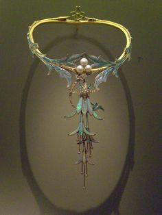 Alphonse Mucha, a favorite artist of the Art Nouveau era.  I love his paintings but I had no idea he designed jewelry.  Love it.