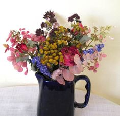 This mini-bouquet includes a few stems of hydrangea, larkspur, wild oregano, Flower Carpet rose buds, tansy and eucalypsus.