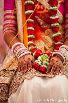 An Indian bride and groom wed in a pink lit Hindu wedding ceremony. BEAUTIFUL! NO COPYRIGHT INFRINGEMENT INTENDED I WISH I KNEW WHERE THE PAGE I FOLLOW GETS THESE PICS SO I COULD PROVIDE THE LINK TO THE PHOTOGRAPHER