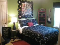 A musical note headboard on the bed and a black, white and red musical theme bedding set make this modern music themed room a rock and roll paradise for a teen girl or boy! Description from pinterest.com. I searched for this on bing.com/images