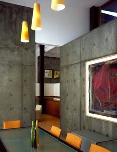 The color of Concrete Homes looks amazing with Orange accents.