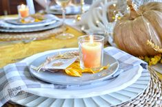 The tablescape I created for Thanksgiving this year was inspired by a recent ad by Pier 1 Imports (yes, again!) which included shades of o. Fall Table Settings, Thanksgiving Table Settings, Thanksgiving Tablescapes, Small Pumpkins, White Pumpkins, Wheat Centerpieces, Square Glass Vase, Grace Home, Grey Runner