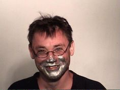 Kelly Gibson. For the 48th time since 1992, the Indiana man has been arrested for inhaling paint fumes. Gibson's latest huffing collar came when his wife summoned cops to the couple's Fort Wayne home shortly after midnight on April 14. As seen in the above mug shot, officers found an impaired Gibson covered in silver paint. He was booked into the Allen County jail for allegedly inhaling toxic vapors.