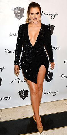 "KHLOÉ KARDASHIAN ""Thank you soooo much @michaelcostello for my fantastic NYE Eve dress!!! Yes I said eve eve lol boy I felt too cute,"" the reality star shared on Instagram of her skin-baring mini, which she teamed with gigantic danglers at a 1 OAK's party in Las Vegas."