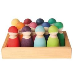 12 Rainbow Peg Dolls come housed in a wooden storage tray. These peg people are painted in a variety of colors with non-toxic stains. Made by Grimm's Spiel & Holz in Germany, these rainbow friends will spark hours of imaginative play. Grimm's Toys, Baby Toys, Kids Toys, Wooden Pegs, Wooden Dolls, Days Of A Week, Articles En Bois, Grimms Rainbow, Wooden Rainbow