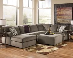 I love this living room sectional! It's contemporary, but still remains functional for the family.