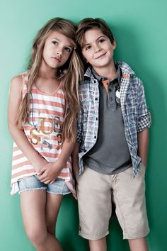 cute brother sister pose but they are much younger