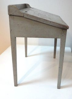 Early 19thc original blue/grey slant top primitive desk.This desk has the best old worn surface.The interior has two little drawers with original shaker style brass pulls...