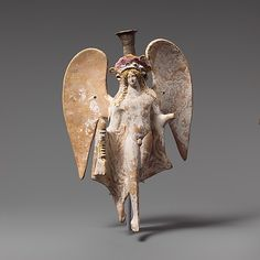 Terracotta lekythos in the form of a flying Eros,late classical period,2nd of  the 4th century BC  Greek-Attic