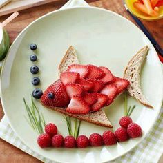Bread and Berries Children's Snack in Fish Shape With Strawberries, Blueberries, and Raspberries.