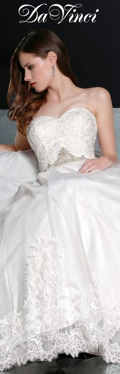 DaVinci Bridal Style # 50193 Tulle ball gown with a sweetheart strapless neckline and a full lace bodice. Beaded trim accents the waist and lace on the hem of the skirt. Chapel length train.  Buttons cover a zipper Back. http://www.davincibridal.com/