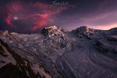 This is a shot of Mount Rosa (or Mont Rose, this explains the title) with his glacier seen from the Gornergrat observatory, at about 3100 m above the sea level, in Switzerland. I took this picture at the late sunset lights, when the clouds surronded the moon that seemed like a little heart. I was very happy to explore these new places and to see these mountain landscapes full of snow.
