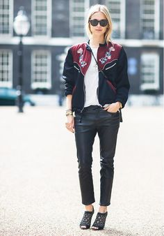 Pernille Teisbaek of Look De Pernille flaunts the chicest letterman jacket with leather pants and heels.