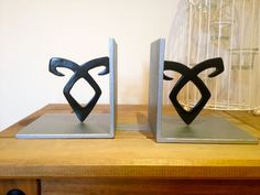 The Mortal Instruments Angelic Power Rune Bookends....I want these sooo much!!
