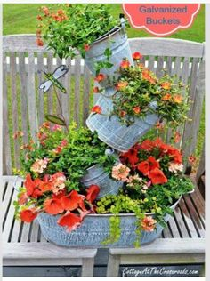 Topsy Turvy Galvanized Flower Buckets.  EASY!   Want to make these this Spring? Share this post to your wall and the tutorial will rain among your photos. http://cottageatthecrossroads.com/topsy-turvy-galvanized-buckets/#comment-22433