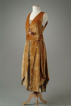 Gold velvet evening gown with a bodice, under-skirt and front panels of gold lame.
