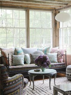 Refined Boheme in a Hamptons Farmhouse. rustic bohemian living space, with wrought iron day bed, patterned cushions, white paper pendant light Architectural Digest, Hamptons House, Living Room Inspiration, House Tours, Farmhouse Decor, Farmhouse Style, Small Spaces, Outdoor Furniture Sets, Family Room