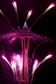 The first minutes of 2017 are celebrated with fireworks shot off of and around the Space Needle, as seen from the roof of Mbar restaurant on Sunday, January 1, 2017. (Logan Reily / The Seattle Times)