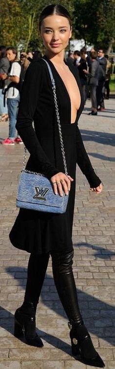 Who made Miranda Kerr's blue handbag and black long sleeve dress that she wore in Paris