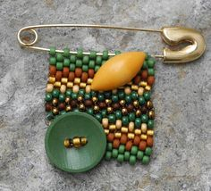 Free Form Beaded Brooch with Vintage Button - Green Gold.  via Etsy.