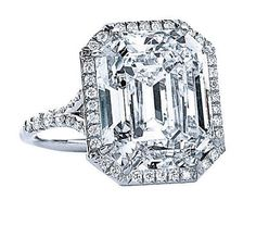Sunny Rays    Simply radiant, this emerald cut ring is made extra-sublime with a halo of pavé diamonds.    By Tiffany & Co.