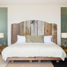Love the curve of this weathered wood headboard.