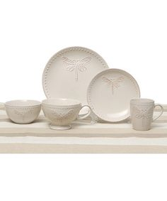 Dragonfly Five-Piece Dinnerware Set  Includes salad plate, dinner plate, cup, mug and bowl Salad plate: 8'' diameter Dinner plate: 10'' diameter Cup: 4.75'' H x 4.25'' diameter Mug: 7.25'' W x 3.75'' H Bowl: 3'' H x 5.5'' diameter Stoneware / ceramic 59.99
