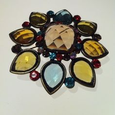 Jeweled Brooch Amber and sea foam tear shaped jewels trimmed w/paprika, plum and babyblue smaller jewels. Bronzed brooch. Looks like stained glass it's so beautiful! Jewelry Brooches