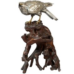 Japanese silvered-bronze falcon on a rootwood stand. ca.1868-1912