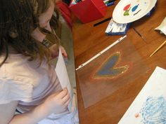 sheet protector art. Use markers or watercolour paint on plastic and print.