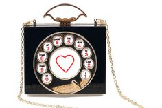 Had your eye on a cute usher throughout the ceremony? Give him a sign with this wonderfully eccentric handbag clutch.