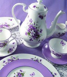 Tea time on china painted with violets and butterflies