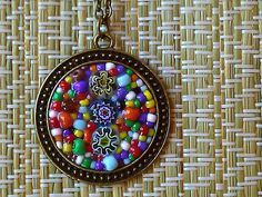 medallion style mosaic pendant with millefiori and multi coloured seed beads