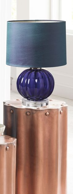Lydia's fluted glass base rests upon a clear acrylic platform, all elegantly topped with an iridescent taffeta shade.