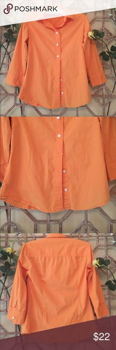 """J Crew orange button down shirt This 97% cotton and 3% spandex button down orange shirt gives just enough stretch that it fits well. Curved hem and 3/4th sleeves with cuff buttons. Sleeve length is 17"""". Collar style.length 24"""" and armpit to armpit is 17 1/2"""" J. Crew Tops Button Down Shirts"""