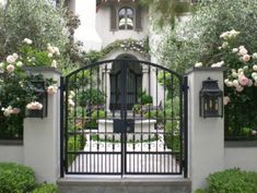 black wrought iron courtyard entrance gate and exterior accents